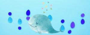 ハートを吹き出すクジラと水滴のイメージ背景の画像